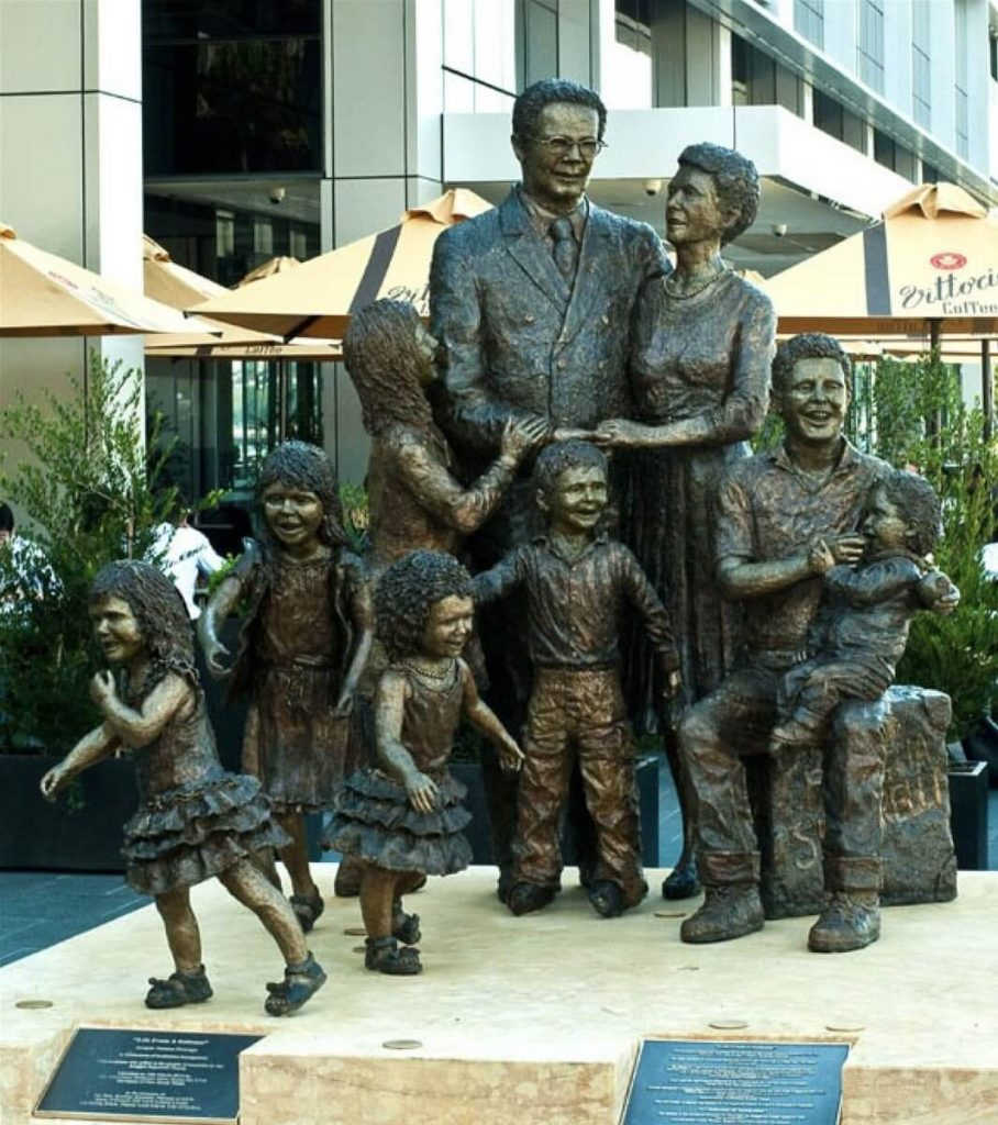 """Life from a suitcase"" Life-sized sculpture of Biaggio and Fina Signorelli with their 7 grandchildren created by Terrance Plowright (Photo credit: Signorelli Family)"