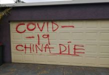 Racist grafitti on a Chinese Australian's garage door | Photo: supplied to ABC News